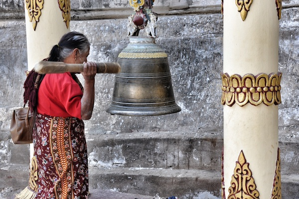 Buddhist Offering prayers to accumulate positive karma