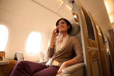 Passenger enjoying inflight mobile phone service on an A380 - Emirates.com