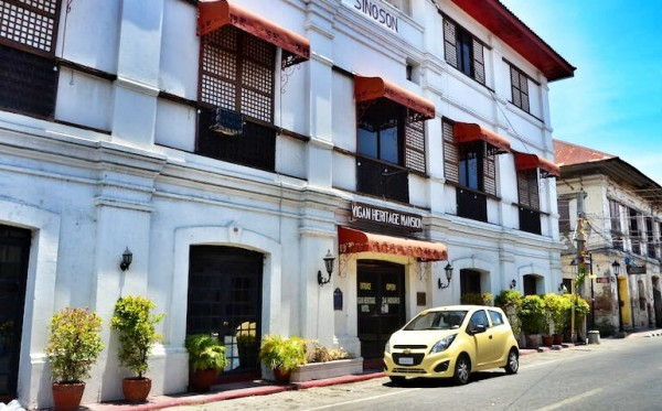 Our Yellow Chevrolet Spark in front of Vigan Heritage Mansion
