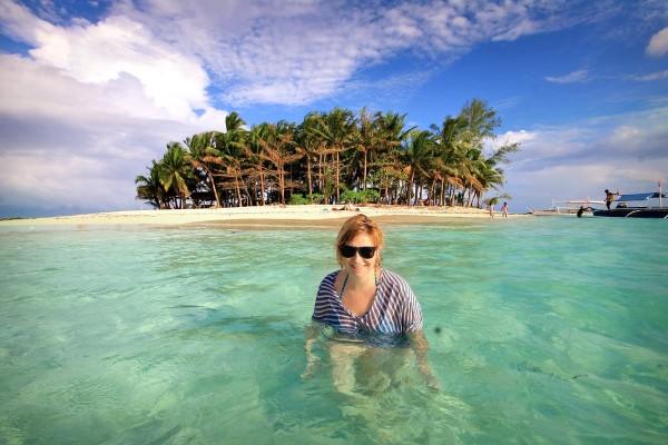 Sabrina enjoying the clear waters of Guyam Island in Siargao Philippines