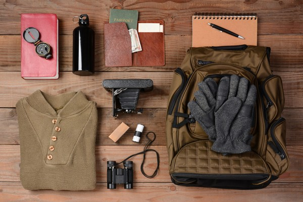 Overhead view of gear laid out for a backpacking trip on a rusti