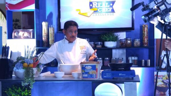 Chef Boy Logro demonstrating his Mayo Mango Empanada