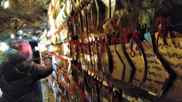 Golden pok jumoni with handwritten wish from cave visitors