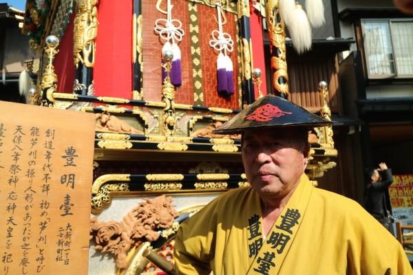 Festival Participant beside their float