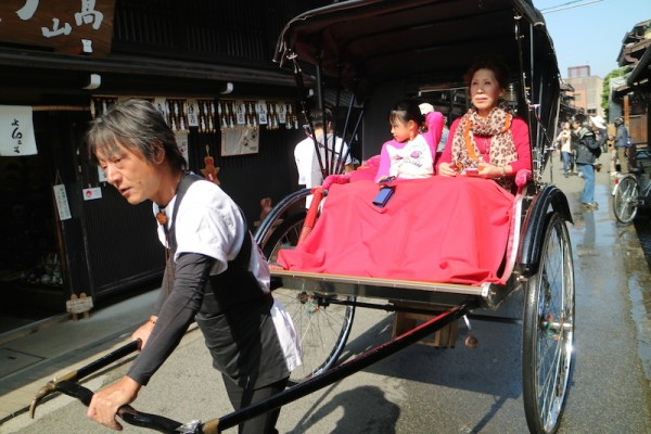 Japanese rickshaw with local tourists