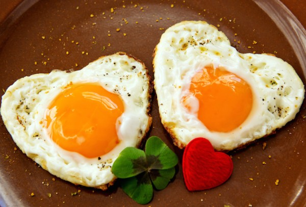 Two heart-shaped fried eggs