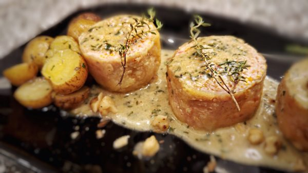 Chicken Ballotine with Walnut Cream Sauce. It's like a Morcon with a slightly softer texture since its made with Chicken
