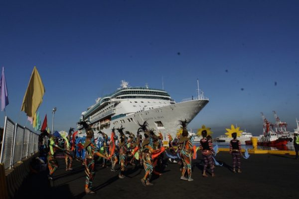 The colorful and lively Ati-Atihan dancers fete the docking Legend of the Seas