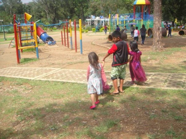 The kids choose their preferred playground at the park