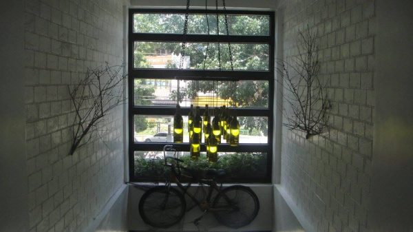 A bamboo bicycle and wine glass chandelier as overhead meditative pieces