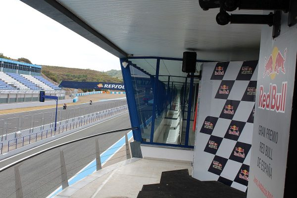 the winner's podium with a line of VIP boxes and the stadium seats across the track