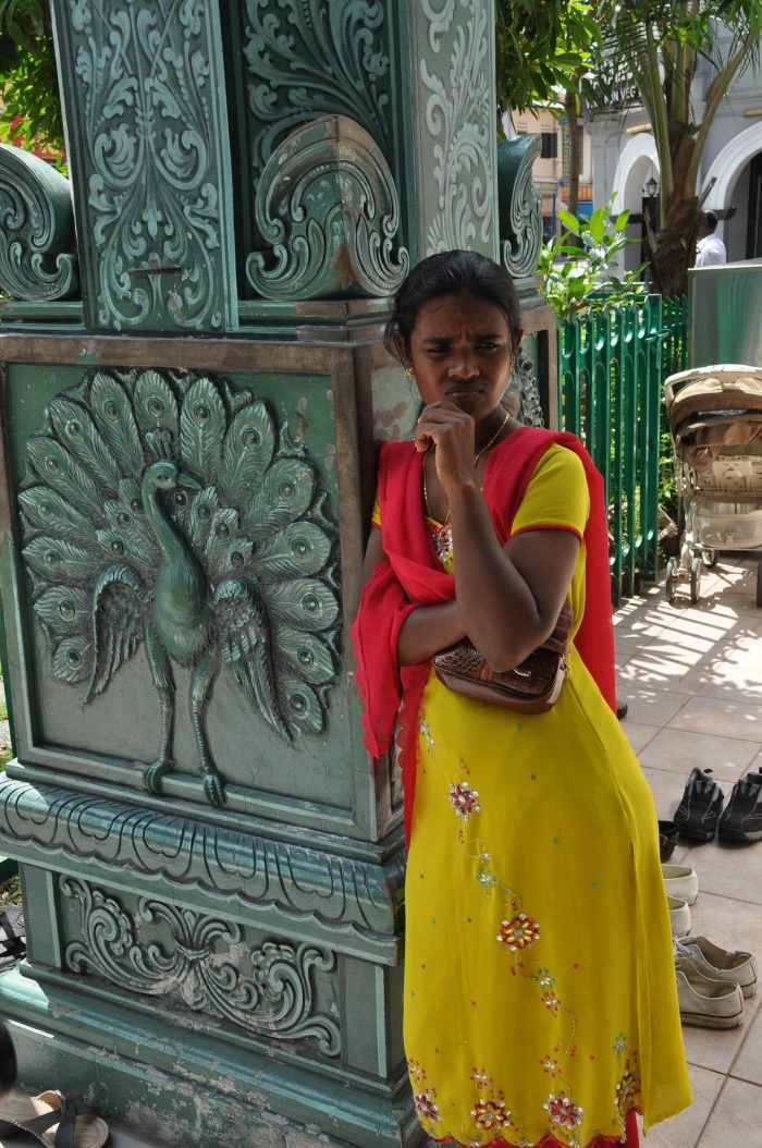 Lady outside Sri Veeramakalimman Temple