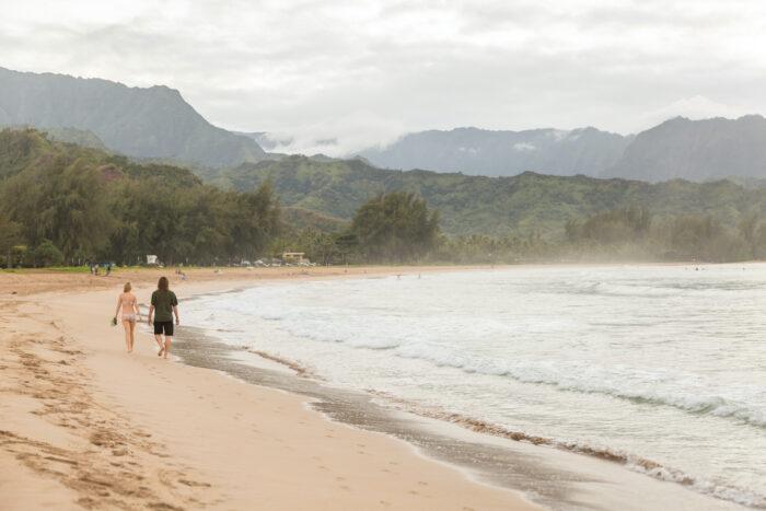 Walking along Hanalei beach, Hawaii photo via DepositPhotos
