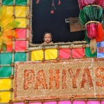 A smiling kid in one of the 2017 Pahiyas Decorated houses