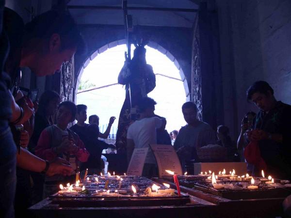 Devotees light candles during 'Visita Iglesia' on Maundy Thursday (San AgustinChurchIntramuros)