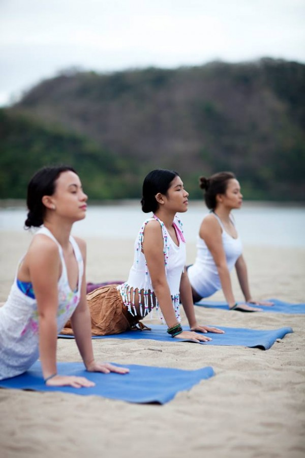 There's no other way to greet the morning than to practice yoga on the beach