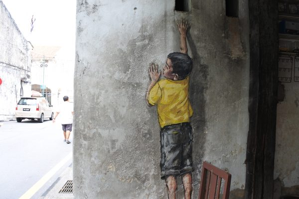 Little Boy Reaching Up by Ernest Zacharevic in Lebuh Cannon