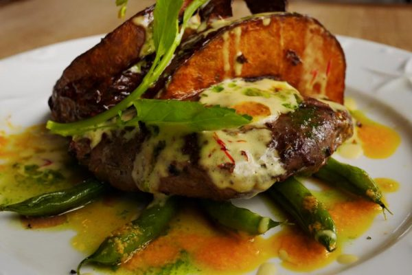 Dijon-Marinated Beef Tenderloin with creamy saffron sauce and potato skins (photo from Hill Station facebook)