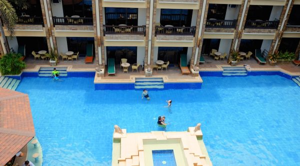 Guests enjoying the vast East Wing pool