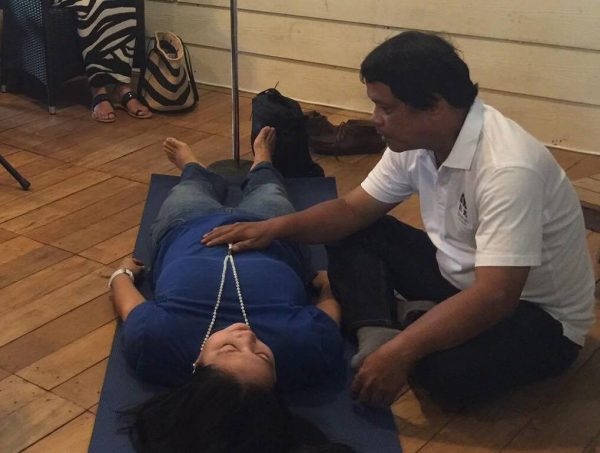 A BodyTalk practitioner does a Whole Healthcare session