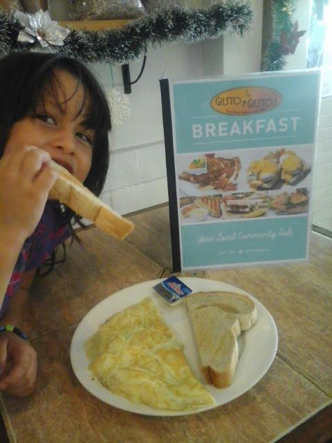 A breakfast of Cheesy Omelet with fresh baked bread alwasy makes kids happy