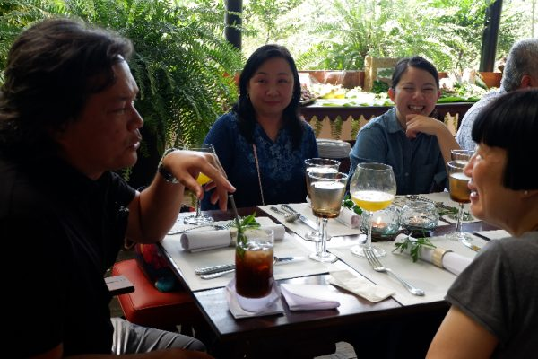 The host, chef Tony Boy Escalante of Antonio's Tagaytay, shares a light moment with guests that include DOT director Verna Buensuceso (background) and international journalists Charmaine Mok of Tatler and Susan Jung of China Morning Post (foreground).