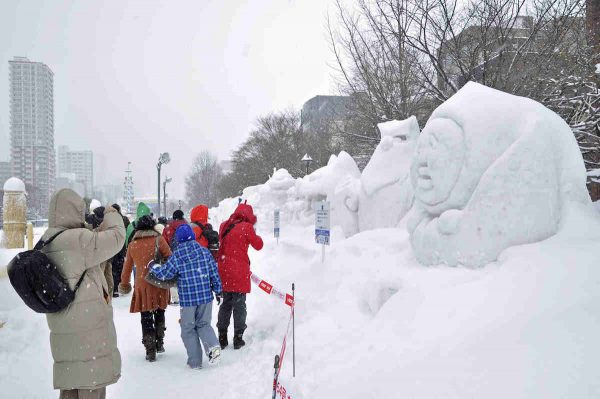 Local and Foreign Tourists taking photos of Snow Sculptures at Sapporo Snow Festival 2017