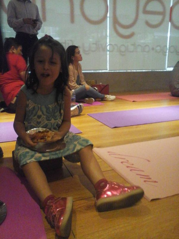 Luna loving her Protein Surprise slice at the launching of Shakey's Quorn Pizza in Beyond Yoga