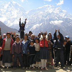 The children and people living on the foot of the mountain are happily posing for a picture in front of the Mount Alps. The picture was featured on the website of United Nations Foundation in promotion for Sustainable Tourism and Development.