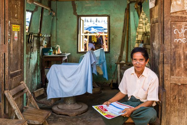 A barber shop in the Hleku street market along the road from Yangon to Bago