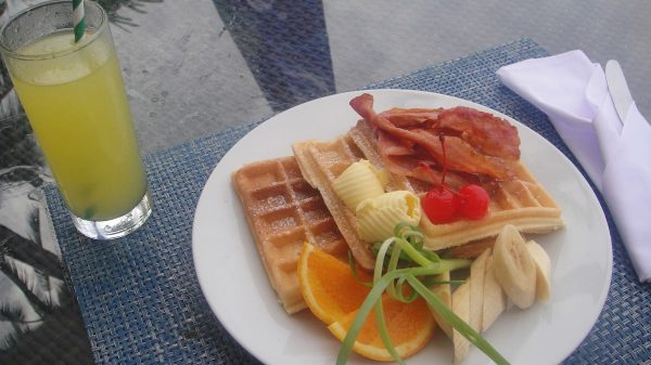 Breakfast Waffles topped with Bacon plus a glass of fresh Calamansi Juice