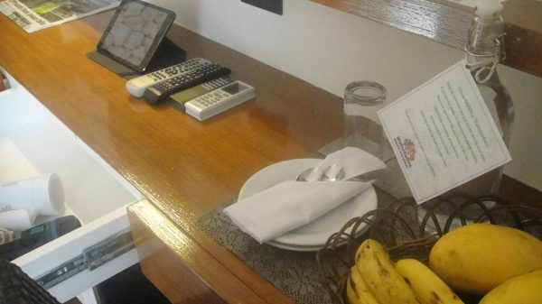 Complimentary fruit basket and a counter filled with travel necessities