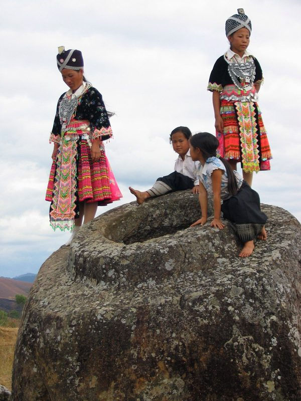 Hmong Girls climbing on one of the jars at Site 1