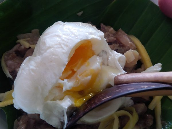 Runny poached egg of top of the traditional and original sisig recipe—strips of steamed pork and green mango marinated in vinegar and fish sauce. More than 20 variants of sisig, from common favorites to exotic fusions were showcased at the Sisig Fiesta, held last year at Angeles City, Pampanga.