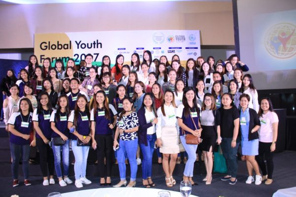 The happy delegates take a picture in front of the GYF 2017 backdrop.