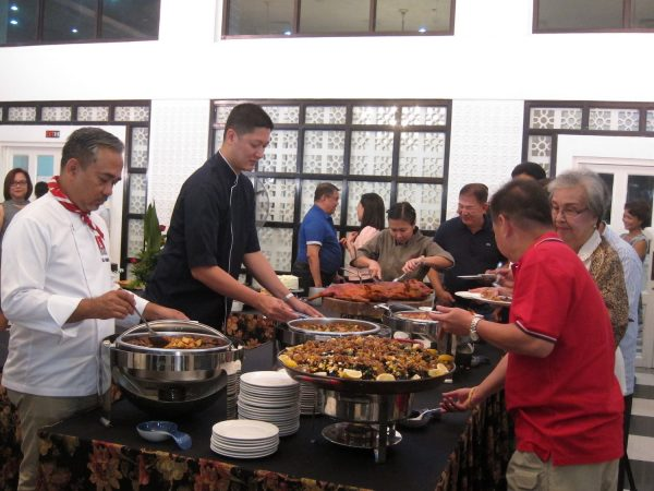 Ige Ramos and Angelo Comsti serving lengua and callos
