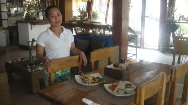 The lovely staff serving food inside the indoor restaurant