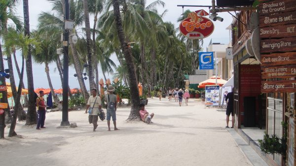 The white sand path in front of Red Coconut Beach Hotel