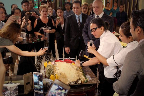 Chef Lau breaks the salt crust on the baked fish while our General Manager Anders Hallden, F&B Director Edwin Acuyan together with Manila based media looks on. This tradition is done when launching a business for good luck and prosperity.