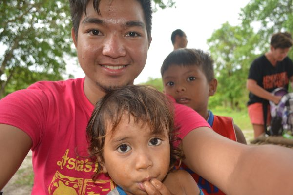Picture taking with a cute Aeta kid