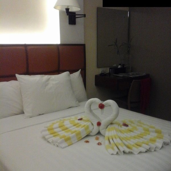 Towel art laid beautifully on a queen bed