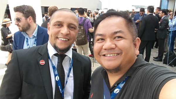 with Roberto Carlos of Real Madrid