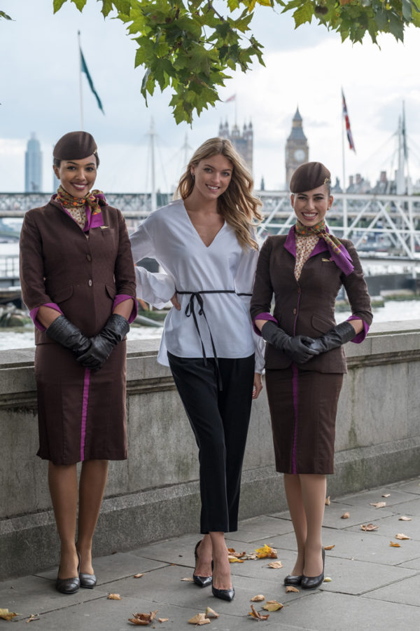 American fashion model Martha Hunt poses in London with members of Etihad Airways' award-winning cabin crew