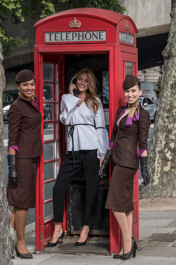 Model Martha Hunt with crew in an iconic British phonebox before walking the runway at celebrated British Julien Macdonald's show at London Fashion Week.