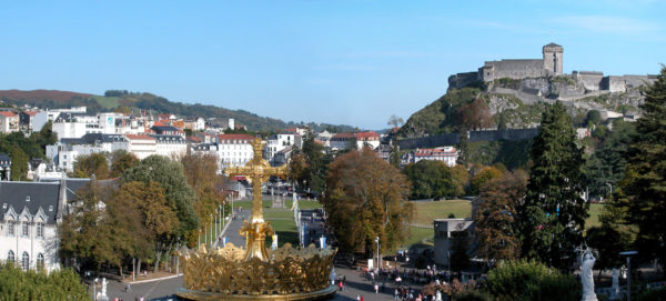 The view from the terrace with the golden cross and the old Roman fortress in the distance.