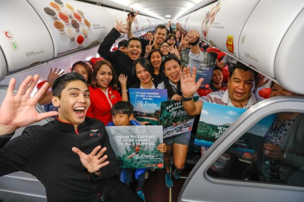 AirAsia is Now offering Davao to Kuala Lumpur Flights - Passengers and crew happily waving onboard AK590
