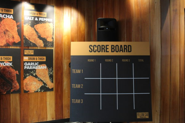 The Yellow Cab team have set up a scoreboard to track each group's score at the event.