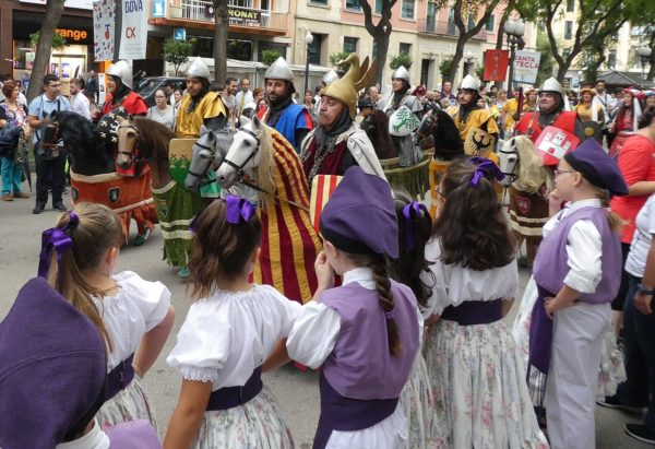 a family-friendly battle scene re-enacted on the Ramblas