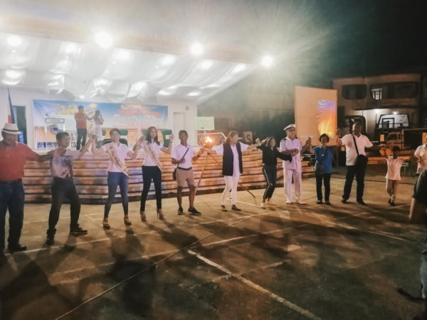 """Mayor Marisa Red Martinez, Miss Earth Philippines reigning beauty queens and the C.O.R.A.L movement organization members singing """"Heal the World"""""""