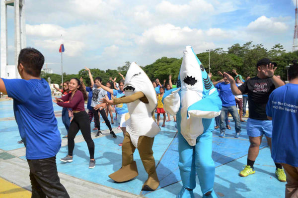 """Shark mascots danced to the tune of """"Under the Sea"""" during a flashmob for the Philippine Rise. The Philippine Rise is an important habitat for marine wildlife, including sharks and rays. ©Oceana"""
